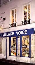 Photo of the Village Voice bookstore at night